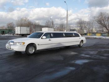 Аренда автомобиля Лимузин Lincoln Town Car белый  с водителем 3